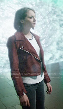 Thea's triangle trim top and red suede moto jacket on Arrow