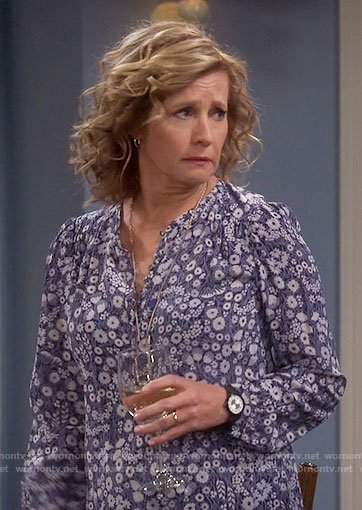 Vanessa's blue floral blouse on Last Man Standing