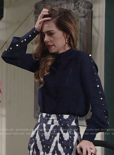 Victoria's navy studded blouse and ikat print pencil skirt on The Young and the Restless