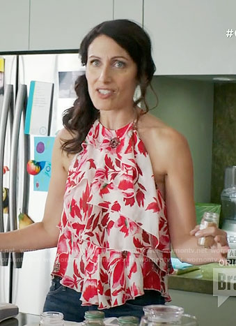 Abby's red floral ruffled top and red lace-up sandals on Girlfriends Guide to Divorce