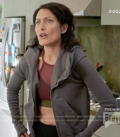 Abby's red mesh sports bra and grey hoodie on Girlfriends Guide to Divorce