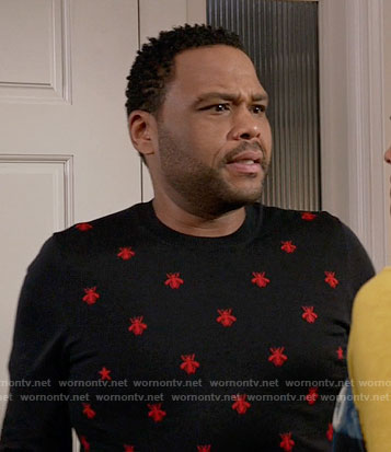 Andre's navy sweater with red embroidered bees on Black-ish