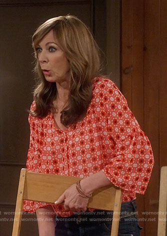 Bonnie's orange printed blouse on Mom