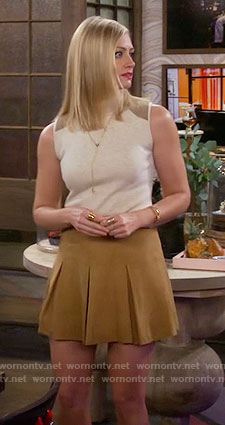 Caroline's sleeveless turtleneck top and pleated skirt on 2 Broke Girls