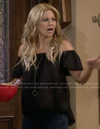 DJ's black off-shoulder top and long square necklace on Fuller House