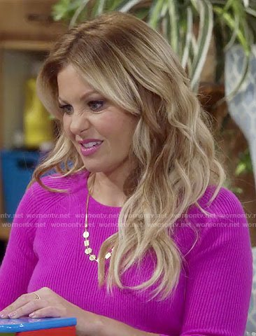 DJ's gold shapes necklace and pink sweater on Fuller House