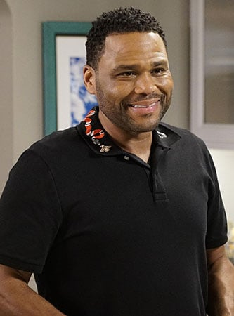 Andre's black polo shirt with snake embroidered collar on Black-ish