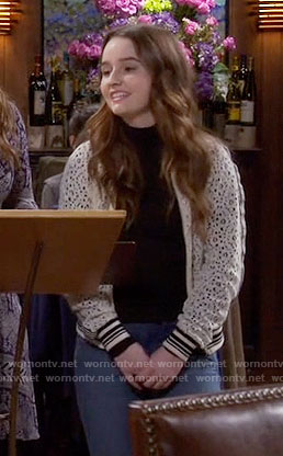 Eve's white lace bomber jacket on Last Man Standing