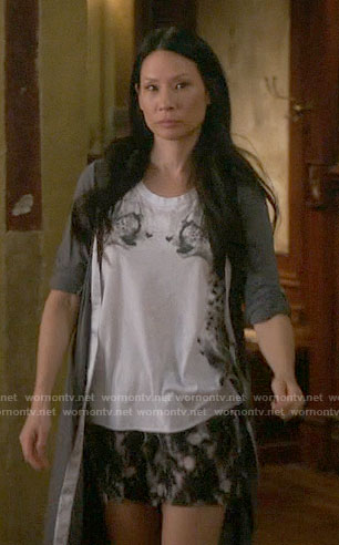 Joan's mirrored cheetah graphic top on Elementary