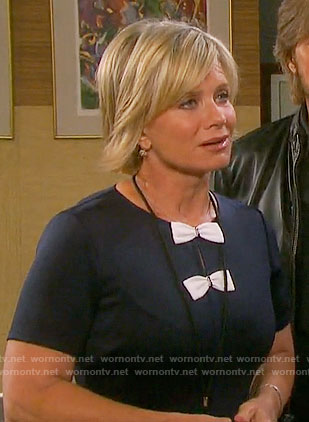 Kayla's navy dress with two white bows on Days of our Lives