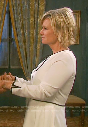 Kayla's white dress with black trim and tie neck on Days of our Lives