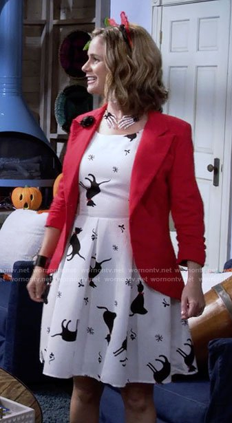 Kimmy's cat print dress and skeleton hands necklace on Fuller House
