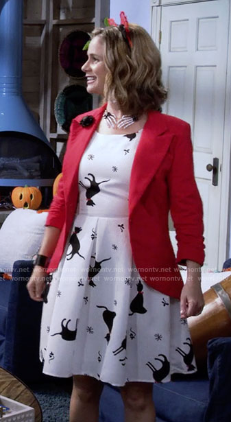 Kimmy's cat print dress, red blazer, and skeleton hands necklace on Fuller House