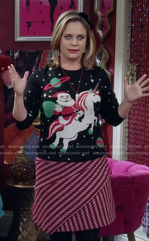 Kimmy's Santa riding a unicorn sweater and pink diagonal stripe skirt on Fuller House