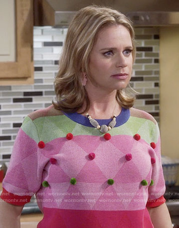 Kimmy's colorblock sweater with pom poms on Fuller House