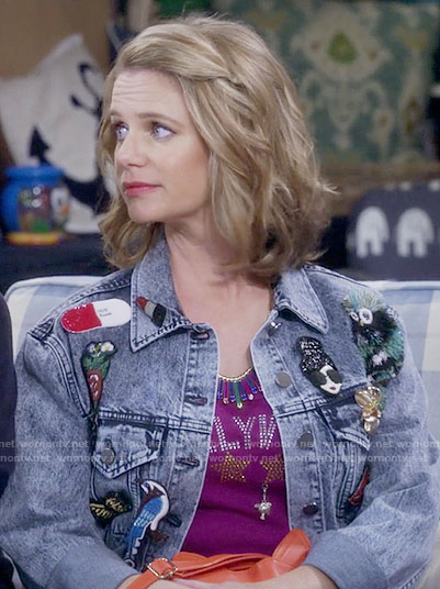 Kimmy's embellished denim jacket and red cat purse on Fuller House