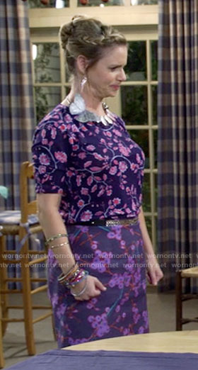 Kimmy's purple and blue floral print top and skirt on Fuller House