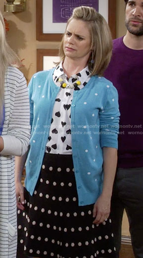 Kimmy's heart print top and polka dot cardigan and skirt on Fuller House