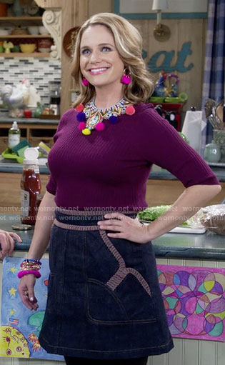 Kimmy's purple sweater and pom pom necklace on Fuller House
