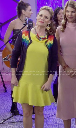 Kimmy's yellow dress, rainbow striped cardigan and taco clutch on Fuller House
