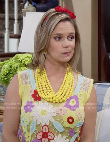 Kimmy's floral crochet top and yellow layered bead necklace on Fuller House