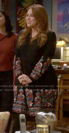 Kristin's black embroidered long sleeve dress on Last Man Standing