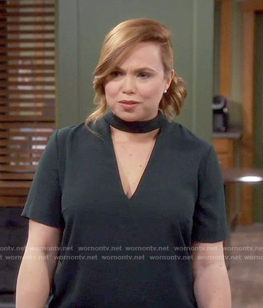 Kristin's dark green dress with triangle cutout on Last Man Standing
