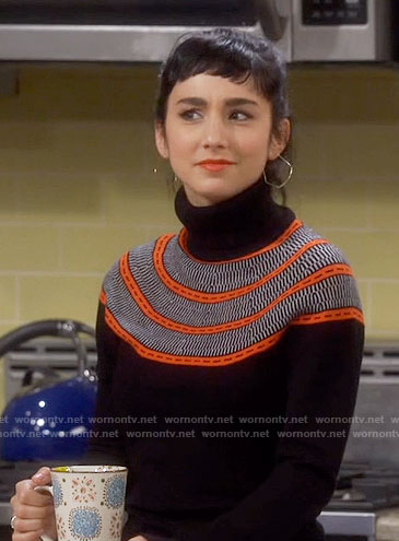 Mandy's black turtleneck sweater with orange stripes on Last Man Standing