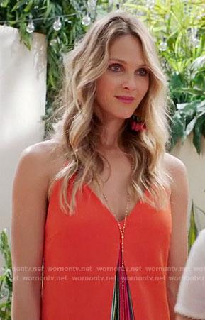 Phoebe's orange dress with rainbow pleats on Girlfriends Guide to Divorce