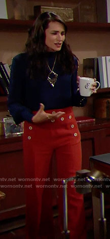 Quinn's blue studded blouse, orange trousers with buttons and leopard print necklace on The Bold and the Beautiful