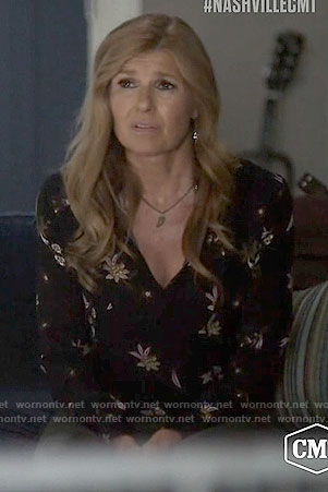 Rayna's black floral long sleeved blouse on Nashville