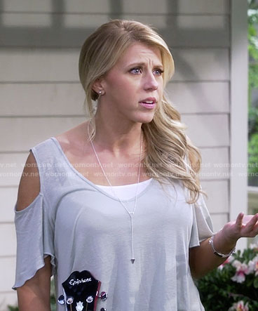 Stephanie's cold shoulder tee and triangle necklace on Fuller House