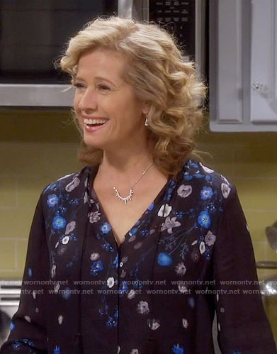 Vanessa's black and blue floral blouse on Last Man Standing