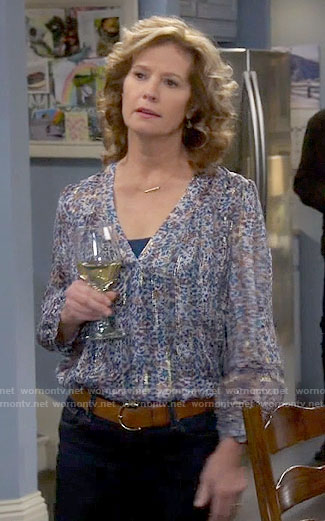 Vanessa's blue printed blouse with metallic stripes on Last Man Standing