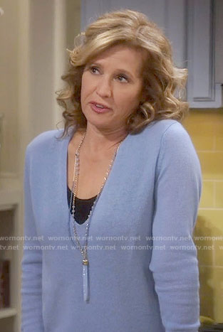 Vanessa's blue v-neck sweater on Last Man Standing