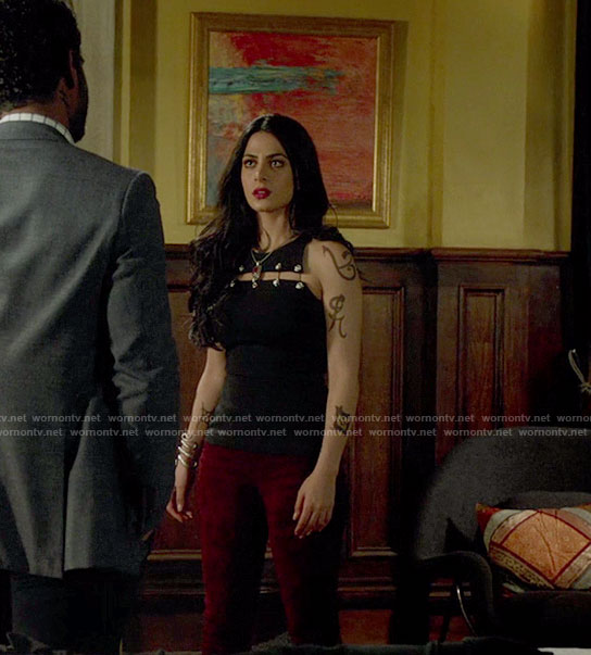 Isabelle's black cutout top with safety pins and suede pants on Shadowhunters