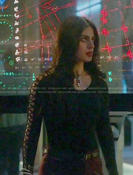 Isabelle's black top with lace up sleeves on Shadowhunters