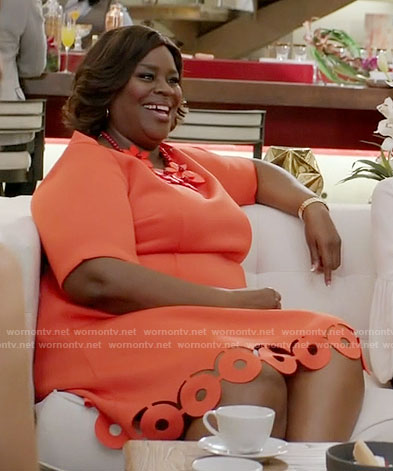 Barbara's orange dress with cutout hem on Girlfriends Guide to Divorce