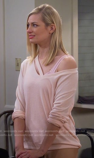 Caroline's beige cutout sweater on 2 Broke Girls
