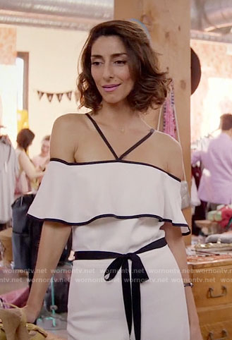 Delia's white off-shoulder jumpsuit on Girlfriends Guide to Divorce