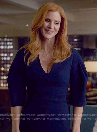Donna's navy blue dress with flared sleeves on Suits