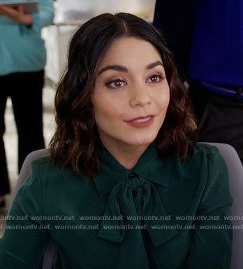 Emily's teal green tie neck blouse on Powerless