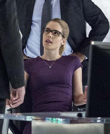 Felicity's purple cap-sleeve dress on Arrow