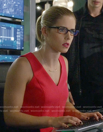 Felicity's white button-detail top silver cage earrings on Arrow