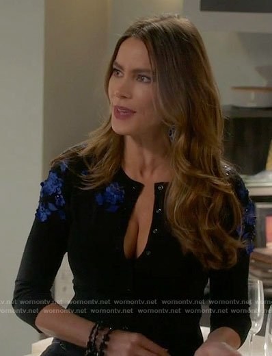 Gloria's black cardigan with blue floral shoulders on Modern Family