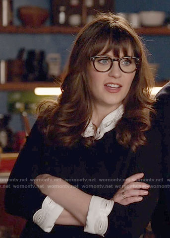 Jess's black dress with white eyelet collar and cuffs on New Girl