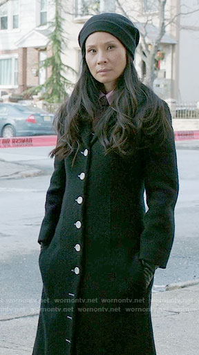 Joan's long black coat with white buttons on Elementary