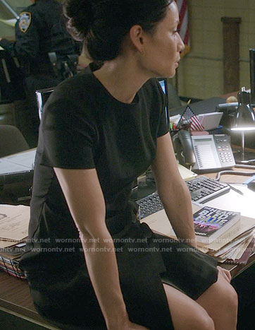 Joan's black short sleeved wrap dress on Elementary