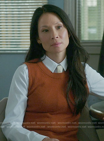 Joan's orange knit shell on Elementary