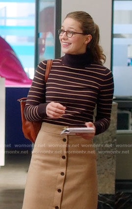 Kara's striped turtleneck sweater and camel button-front skirt on Supergirl